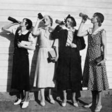 Flappers drinking from bottles